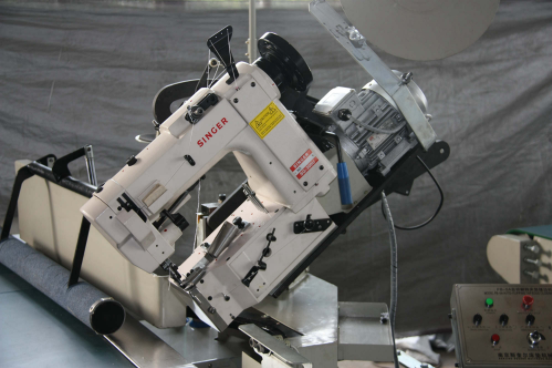 How to trouble shoot the problem of singer 300U sewing head on mattress tape edge machine